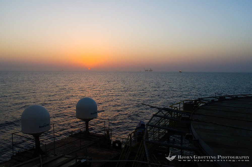 Azerbaijan. Caspian Sea. Sunset as seen from the DBA barge at an oil field in the Caspian Sea.