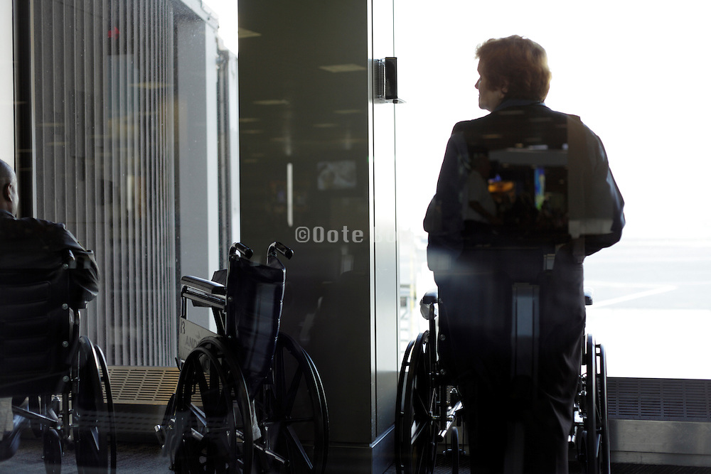 airport personal at gate waiting with wheelchairs