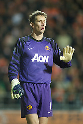 BLACKPOOL, ENGLAND - Tuesday, January 25, 2011: Manchester United's goalkeeper Edwin van der Sar in action against Blackpool during the Premiership match at Bloomfield Road. (Photo by David Rawcliffe/Propaganda)