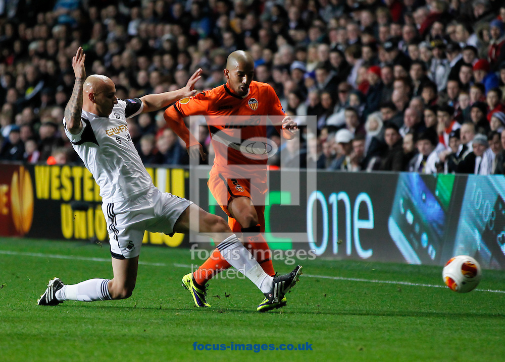 Picture by Mike  Griffiths/Focus Images Ltd +44 7766 223933<br /> 28/11/2013<br /> Jonjo Shelvey of Swansea City and Sofiane Feghouli of Valencia Club de F&uacute;tbol during the UEFA Europa League match at the Liberty Stadium, Swansea.