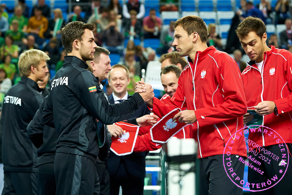 (L) Laurynas Grigelis from Lithuania and (R) Lukasz Kubot of Poland during first day the Davies Cup / Group I Europe / Africa 1st round tennis match between Poland and Lithuania at Orlen Arena on March 6, 2015 in Plock, Poland<br /> Poland, Plock, March 6, 2015<br /> <br /> Picture also available in RAW (NEF) or TIFF format on special request.<br /> <br /> For editorial use only. Any commercial or promotional use requires permission.<br /> <br /> Mandatory credit:<br /> Photo by &copy; Adam Nurkiewicz / Mediasport