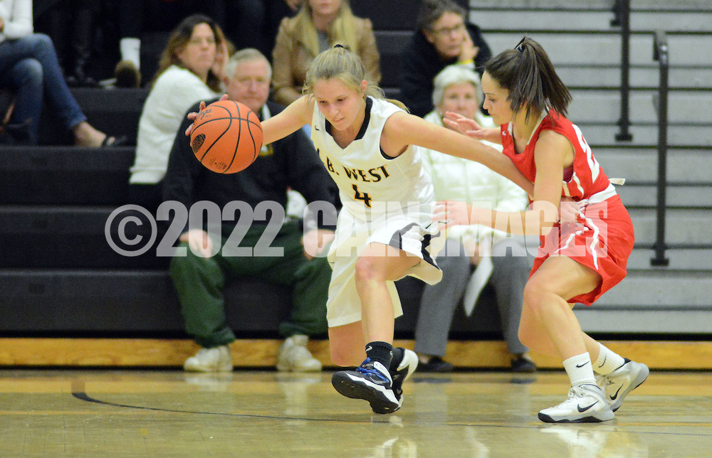 Central Bucks West's Madeleine Maio (4) drives to the net as Souderton's Marissa Sandone (22) defends in the second quarter at Central Bucks West Friday December 18, 2015 in Doylestown, Pennsylvania. (Photo by William Thomas Cain)