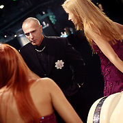 Russian artist Andrej Dzjikija talks to models standing by a car at the Millionaire Fair in Moscow. .Millionaires, billionaires and those who bought 1,000-rouble tickets were among the thousands who visited the fair held in the Crocus city expo centre. .The four-day event, held for the second year in a row, ended on October 30. The products on sale include a diamond-studded mobile phone worth a million dollars, an island, latest sports cars and other items that might appeal to the growing millionaire market..Twenty years ago, there were no official millionaires in the whole of Russia. Now Moscow has 25 billionaires and the country has 88,000 millionaires, according to Forbes Magazine. ..
