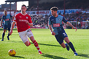 Mike-Steven Bahre of Barnsley (21) gets past Joe Jacobson of Wycombe Wanderers (3) during the EFL Sky Bet League 1 match between Barnsley and Wycombe Wanderers at Oakwell, Barnsley, England on 16 February 2019.