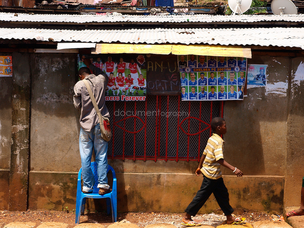 Football posters, Kroo Bay, Freetown, Sierra Leone
