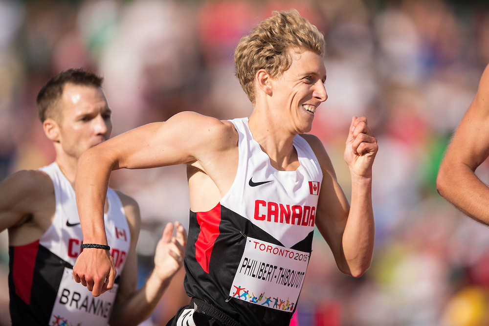 Charles Philbert-Thiboutot of Canada competes in the men's 1500 metres at the 2015 Pan American Games at CIBC Athletics Stadium in Toronto, Canada, July 24,  2015.  AFP PHOTO/GEOFF ROBINS