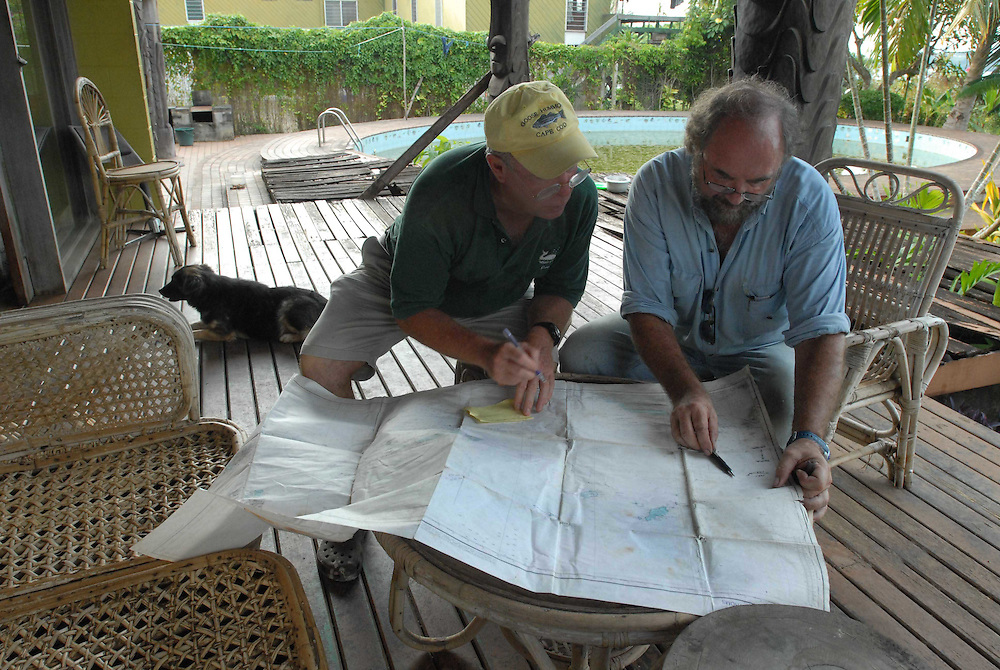 Papua New Guinea (Oct. 25, 2007) -- Grant Wilson goes over a reef map with a local diver in Wewak, Papua New Guinea.  Photo by Johnny Bivera