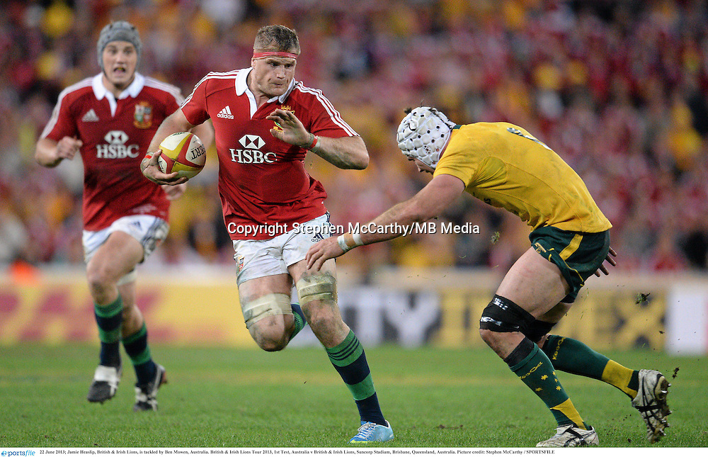 22 June 2013; Jamie Heaslip, British & Irish Lions, is tackled by Ben Mowen, Australia. British & Irish Lions Tour 2013, 1st Test, Australia v British & Irish Lions, Suncorp Stadium, Brisbane, Queensland, Australia. Picture credit: Stephen McCarthy / SPORTSFILE