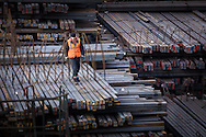 A man preparing steel 'sticks' for export in the Russian Black Sea port of Novorossiysk