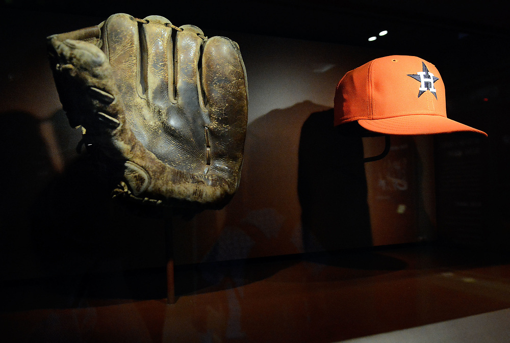 jt051917g/ sports/jim thompson/  The glove of Willie Mays from the famed over the shoulder catch from the 1954 world series game and the hat worn by  Nolan Ryan when he tossed his 5th career no-hitter on Sept. 26, 1981 eclipsing the mark held by Dodger great Sandy Koufax. Friday May. 19, 2017. (Jim Thompson/Albuquerque Journal)