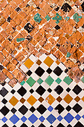 Old / restored Moroccan zelij mosaic wall / doorway tiling, El Badi Palace, Marrakesh, Morocco, 2016–04-22. <br />