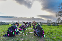 © Licensed to London News Pictures. 20/12/2015 ROLLRIGHT STONES, OXFORDSHIRE.<br /> Winter Solstice celebrations at the Ancient Rollright Stones in Oxfordshire. Druids performed a ceremony as the sun rose and the Boerma Morris performed their traditional Morris dances inside the stone circle.<br /> Photographer : Mark HemsworthPhoto credit : MARK HEMSWORTH/LNP