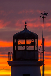 © Licensed to London News Pictures. 18/09/2019. Scarborough UK. A bird sits on top of the light house in Scarborough harbour at dawn this morning on the Yorkshire coast. Photo credit: Andrew McCaren/LNP