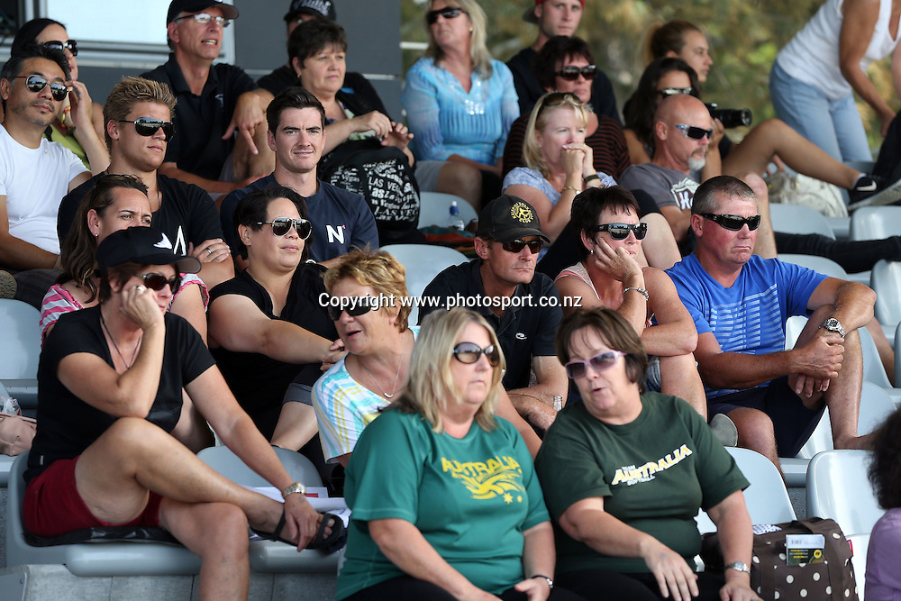 The fans in the grandstand during game three of the Trans Tasman Softball Series between the New Zealand Black Sox and the Australian Steelers at Tradestaff Rosedale Park in Albany, Auckland on 29 March 2014. Photo: Jason Oxenham / www.photosport.co.nz