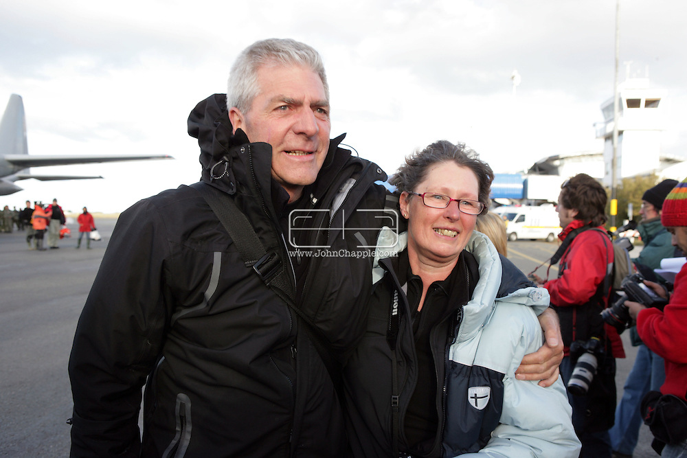"24th November 2007, Punta Arenas, Chile. Survivors from the shipwrecked Antarctic vessel M/S Explorer arrive at Punta Arenas by military aircraft. 154 tourists and crew had spent the night on King George Island after their ship struck an iceberg and sank approximately 120km (75 miles) north of the Antarctic Peninsula. After several hours bobbing in small lifeboats surrounded by floating sheets of ice, they were plucked to safety by the Norwegian cruise ship, the Nordnorge. The ""Spirit of Shackleton"" 19-day cruise through the Drake Passage, cost from around $8,000 (£3,900) per cabin. Pictured Pieter Jannenga and Henny Mulder from Holland arriving in Punta Arenas.PHOTO © JOHN CHAPPLE / REBEL IMAGES.john@chapple.biz   www.chapple.biz"