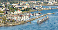 An aerial view of Campbell River's trademark Discovery Pier and waterfront marina in Discovery Passage.  Campbell River, Vancouver Island, British COlumbia, Canada.