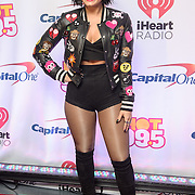 DEMI LOVATO walks the red carpet at the Hot 99.5 Jingle Ball at the Verizon Center in Washington, D.C.