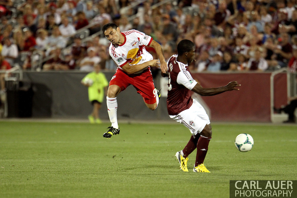 July 4th, 2013 - New York Red Bulls forward Fabian Espindola (9) has the ball stollen from him by Colorado Rapids defender German Mera (33) in second half action of the Major League Soccer match between New York Red Bulls and the Colorado Rapids at Dick's Sporting Goods Park in Commerce City, CO