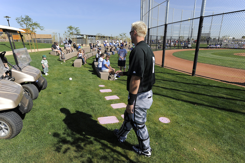 "GLENDALE, AZ - FEBRUARY 26:  A.J. Pierzynski #12 of the Chicago White Sox plays catch with a young fan during a ""B"" game between the Los Angeles Dodgers and Chicago White Sox on February 26, 2009 at Camelback Ranch in Glendale, Arizona. (Photo by Ron Vesely)"