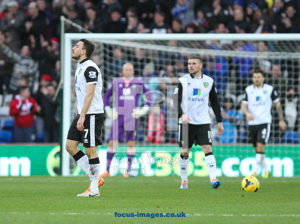 Picture by Tom Smith/Focus Images Ltd 07545141164<br /> 01/02/2014<br /> Robert Snodgrass (left) of Norwich City appears dejected after Cardiff level the scores the Barclays Premier League match at the Cardiff City Stadium, Cardiff.