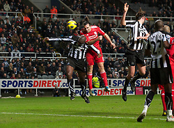 NEWCASTLE, ENGLAND - Saturday, December 11, 2010: Liverpool's Sotirios Kyrgiakos and Newcastle United's Sol Campbell during the Premiership match at St James' Park. (Photo by: David Rawcliffe/Propaganda)