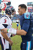 NASHVILLE, TN - DECEMBER 3:  Tom Savage #3 of the Houston Texans shakes hands with Marcus Mariota #8 of the Tennessee Titans at Nissan Stadium on December 3, 2017 in Nashville, Tennessee.  The Titans defeated the Texans 23-14.  (Photo by Wesley Hitt/Getty Images) *** Local Caption *** Tom Savage; Marcus Mariota