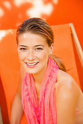 Woman on Orange Deck Chair Smiling