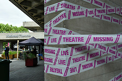 © Licensed to London News Pictures. 03/07/2020. LONDON, UK.  Pink tape has been wrapped around the National Theatre on the South Bank as part of the #MissingLiveTheatre initiative, a project by theatre designers Scene Change to support those in the live theatre industry through Covid-19 and to help theatres bring shows back into production.  So far, 50 theatres across the UK have signed up to the initiative.  Theatres are remain closed even though the UK government has relaxed certain coronavirus pandemic lockdown restrictions allowing other businesses to reopen.  Photo credit: Stephen Chung/LNP