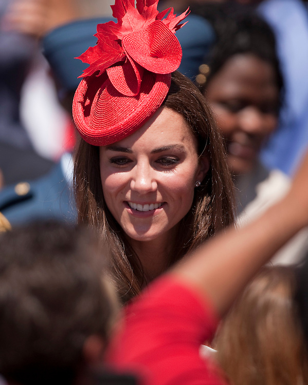 Catherine the Duchess of Cambridge greets well wishers following  Canada Day celebrations on Parliament Hill in Ottawa, Canada, July 1, 2011. The duke and Duchess are on a nine day tour of Canada, their first official foreign trip as husband and wife.<br /> AFP PHOTO/GEOFF ROBINS
