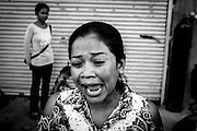 A community activist cries during a protest staged by Borei Keila residents. Despite years of protesting, many families have yet to receive adequate compensation from Phanimex. The community of Borei Keila in Phnom Penh was once home to hundreds of families before land developer Phanimex bought the property rights to the area and forcefully evicted the residents who refused to accept their compensation package. Those who remained were forced to squat in the remains of the buildings, living in slum-like conditions and without access to plumbing or public electiricity.