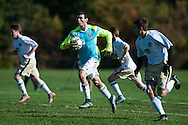 Essex goalie Paul Federico (1) runs with the ball after making a save during the boys soccer game between the Champlain Valley Union Redhawks and the Essex Hornets at Essex High School on Saturday mooring October 10, 2015 in Essex. (BRIAN JENKINS/For the FREE PRESS)