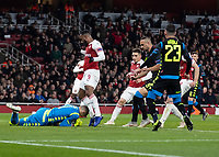 Football - 2018 / 2019 UEFA Europa League - Quarter Final, First Leg Arsenal vs. Napoli <br /> <br /> Alex Meret (Napoli) dives at the feet of Alexandre Lacazette (Arsenal FC) at The Emirates.<br /> <br /> COLORSPORT/DANIEL BEARHAM