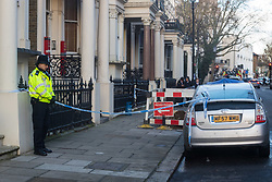 A police officer stands guard at the cordoned off entrance to   29 Holland Park Gardens after a fire in a flat on the first floor of the converted house claims the life of a man and his dog in Holland Park, West London. February 07 2018.
