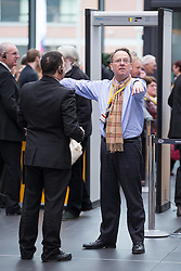 © Licensed to London News Pictures . 15/03/2015 . Liverpool , UK . TV presenter MICHAEL CRICK is searched upon entry to the conference . The Liberal Democrat Party Conference at the Arena and Conference Centre in Liverpool . Photo credit : Joel Goodman/LNP