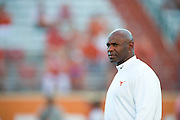 AUSTIN, TX - AUGUST 30:  Texas Longhorns head coach Charlie Strong looks on during warmups before kickoff against the North Texas Mean Green on August 30, 2014 at Darrell K Royal-Texas Memorial Stadium in Austin, Texas.  (Photo by Cooper Neill/Getty Images) *** Local Caption *** Charlie Strong