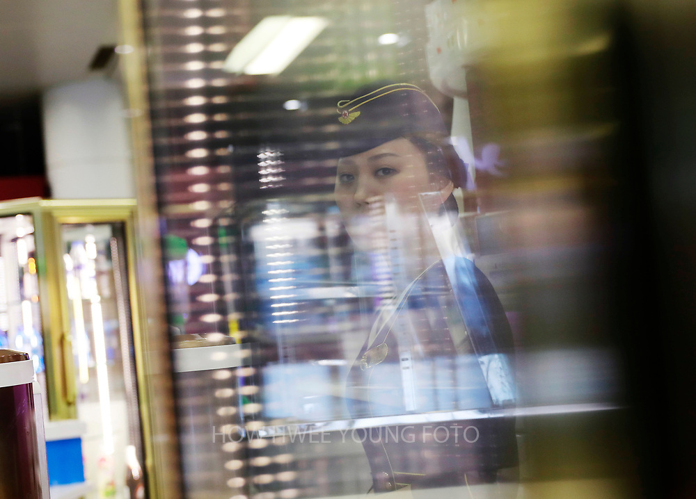 A picture made available on 12 April 2017 shows a North Korean service staff seen behind a glass cabinet at a food and beverage station in Pyongyang Airport in Pyongyang, North Korea, 11 April 2017. North Koreans prepare to celebrate the 'Day of the Sun Festival', 105th birthday anniversary of former North Korean supreme leader Kim Il-sung in Pyongyang on 15 April.
