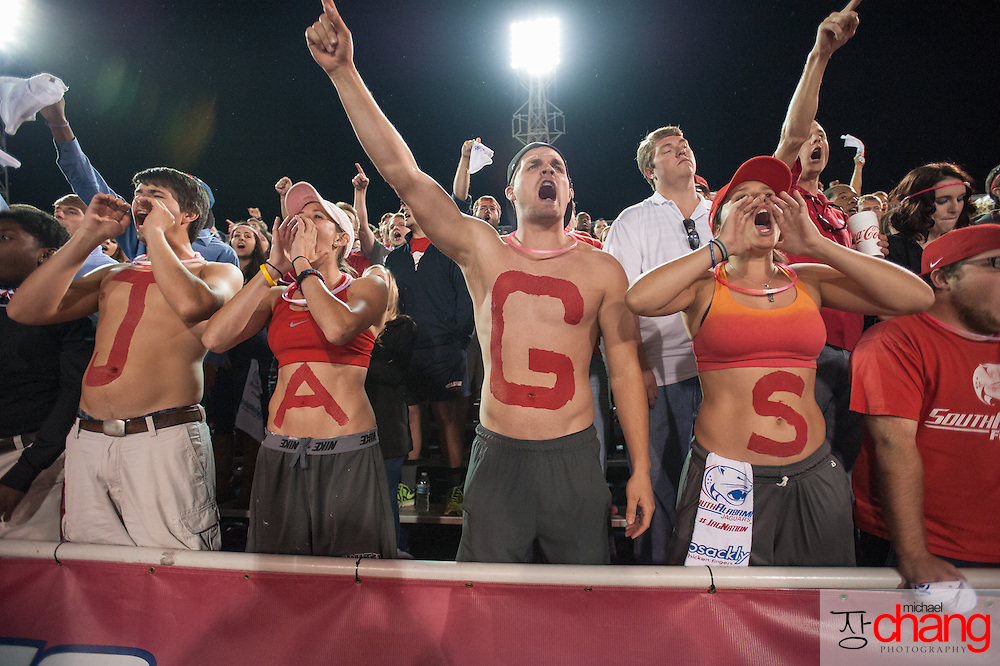 MOBILE, AL - OCTOBER 24: South Alabama Jaguars fans cheer for their team during their game against the Troy Trojans on October 24, 2014 at Ladd-Peebles Stadium in Mobile, Alabama.  The South Alabama Jaguars defeated the Troy Trojans 27-13. (Photo by Michael Chang/Getty Images) *** Local Caption ***