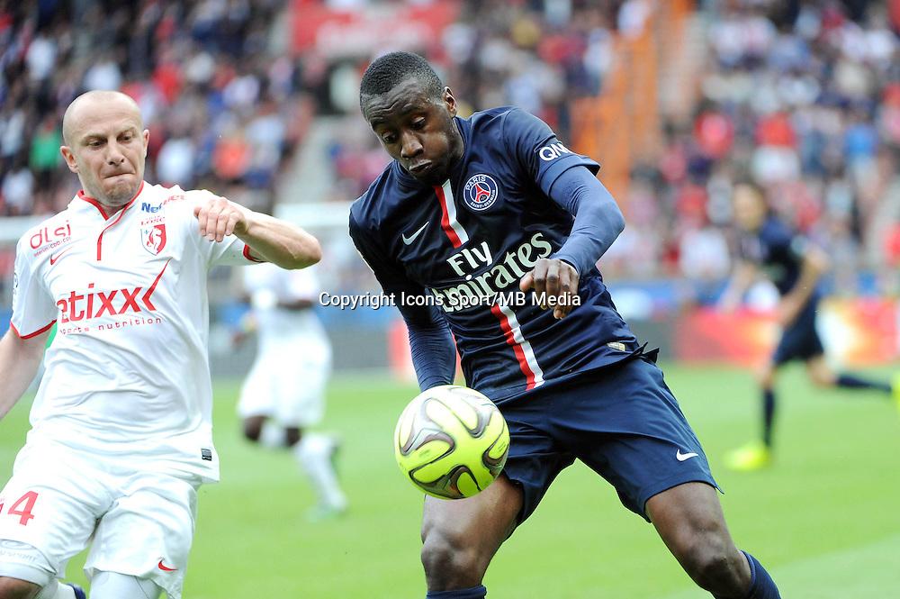 Blaise MATUIDI / Florent BALMONT - 25.04.2015 - Paris Saint Germain / Lille - 34eme journee de Ligue 1<br />Photo : Nolwenn Le Gouic / Icon Sport