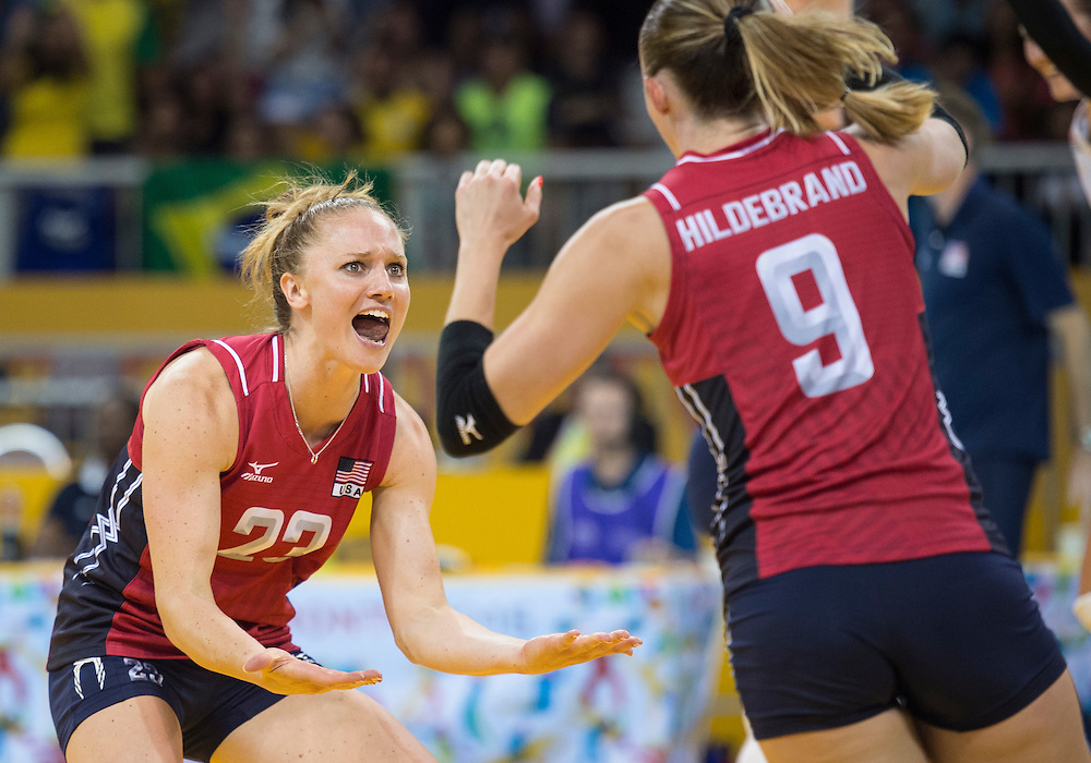 Women's volleyball finals-USA vs. Brazil- Carli Lloyd (left) and Kristen Lynn Hidebrand of Team USA react to winning the point to make it match point en route to their gold medal victory during competition at the 2015 PanAm Games in Toronto.