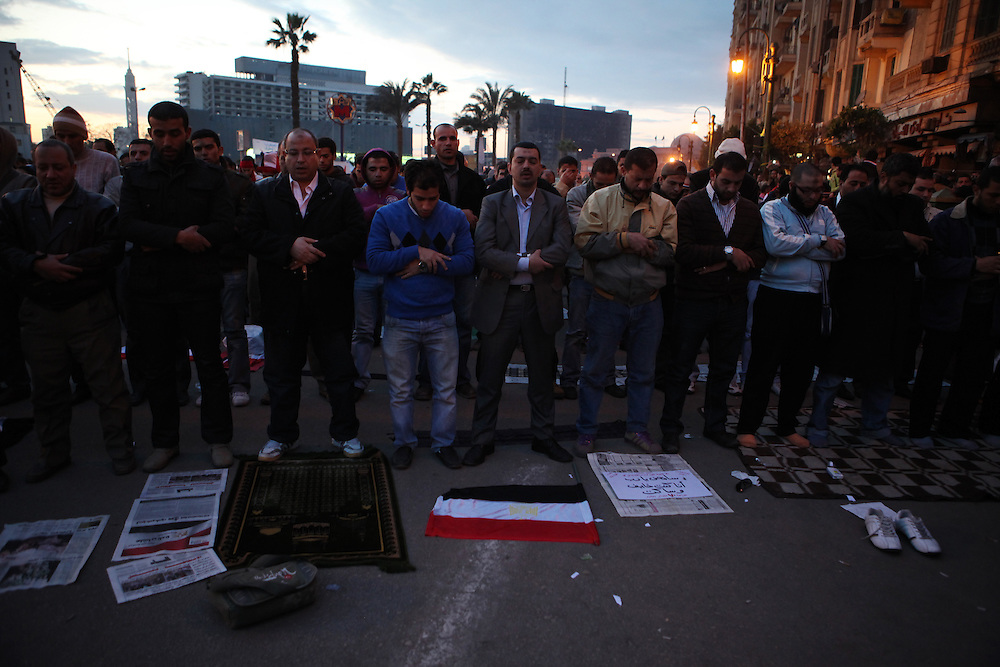Men pray at Tahrir Square.
