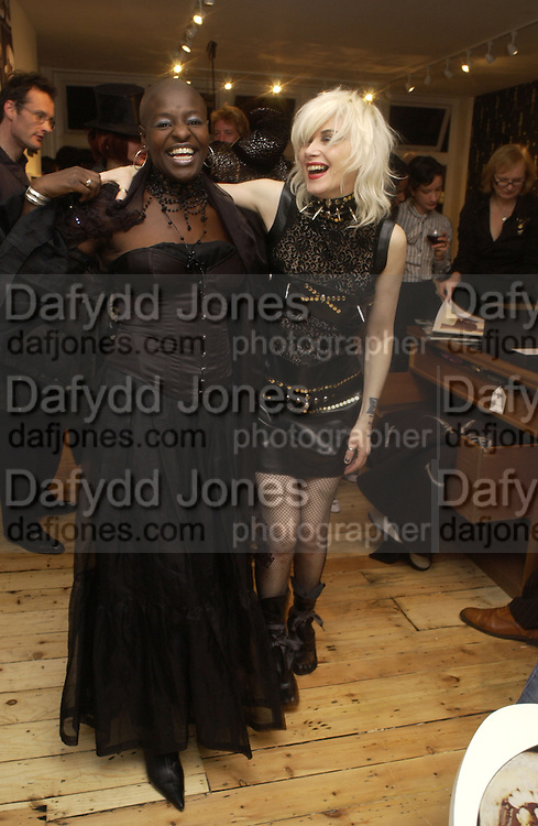 Millie Laws and Pam Hogg. Abigail Lane and Showroom Dummies at Bone Idle, The Shop. Charing X Gallery. Charing Cross Rd. 31 October 2005. ONE TIME USE ONLY - DO NOT ARCHIVE © Copyright Photograph by Dafydd Jones 66 Stockwell Park Rd. London SW9 0DA Tel 020 7733 0108 www.dafjones.com