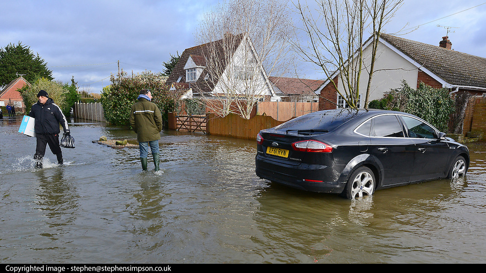 © Licensed to London News Pictures. 09/02/2014. Wraysbury, UK. Property and cars were left standing in floodwater.  Flooding in Wraysbury in Berkshire today 9th February 2014 after the River Thames burst its banks. Photo credit : Stephen Simpson/LNP
