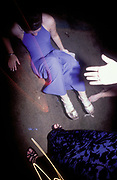 A girl who has fallen over is offered a hand up, Glamorgan University Ball, Treforest, Wales, 1997