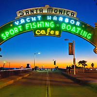 The historic Santa Monica Pier neon sign  amid the sunset on Thursday, December 20, 2012.  The neon sign was installed in 1940 by the Santa Monica Businessmen's Association to celebrate the opening of the pier's newly built ramp. Today it stands as a symbol for the California lifestyle and is a huge tourist destination all year long..