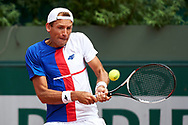 Paris, France - 2017 June 02: Lukasz Kubot from Poland plays a backhand while his men's double match second round during tennis Grand Slam tournament The French Open 2017 (also called Roland Garros) at Stade Roland Garros on June 02, 2017 in Paris, France.<br /> <br /> Mandatory credit:<br /> Photo by © Adam Nurkiewicz<br /> <br /> Adam Nurkiewicz declares that he has no rights to the image of people at the photographs of his authorship.<br /> <br /> Picture also available in RAW (NEF) or TIFF format on special request.<br /> <br /> Any editorial, commercial or promotional use requires written permission from the author of image.