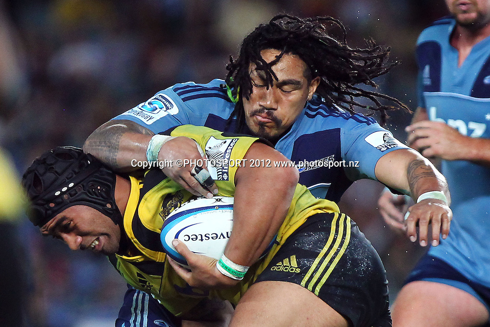 Blues' Ma'a Nonu tackles Hurricanes' Victor Vito. Super Rugby rugby union match, Blues v Hurricanes at Eden Park, Auckland, New Zealand. Friday 23rd March 2012. Photo: Anthony Au-Yeung / photosport.co.nz
