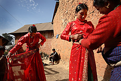 Surita Shreshta Balami, 16, left, and her sister Purnima Shreshta Balami, 15, right, prepare for their weddings in Kagati Village, Kathmandu Valley, Nepal on Jan. 24, 2007. However, Purnima was told she was marrying the Sun god, a Newari cultural tradition, not a young man. She later ran away from the ceremony and refused to marry the young man who showed up.The Kagati village, a Newar community, is most well known for its propensity towards this practice. Many Hindu families believe blessings will come upon them if marry off their girls before their first menstruation.