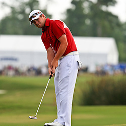 2009 April 26: Aaron Watkins of Mesa, AZ putts on the 18th hole during the final round of the Zurich Classic of New Orleans PGA Tour golf tournament played at TPC Louisiana in Avondale, Louisiana.