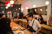 Chef-owner Pamela Yung alking to some diners at Semilla.