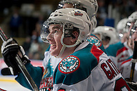 KELOWNA, CANADA - MARCH 23: Joe Gatenby #28 of the Kelowna Rockets is all smiles on the bench as he watches the replay after scoring his first WHL goal against the Tri-City Americans on March 23, 2014 at Prospera Place in Kelowna, British Columbia, Canada.   (Photo by Marissa Baecker/Shoot the Breeze)  *** Local Caption *** Joe Gatenby;